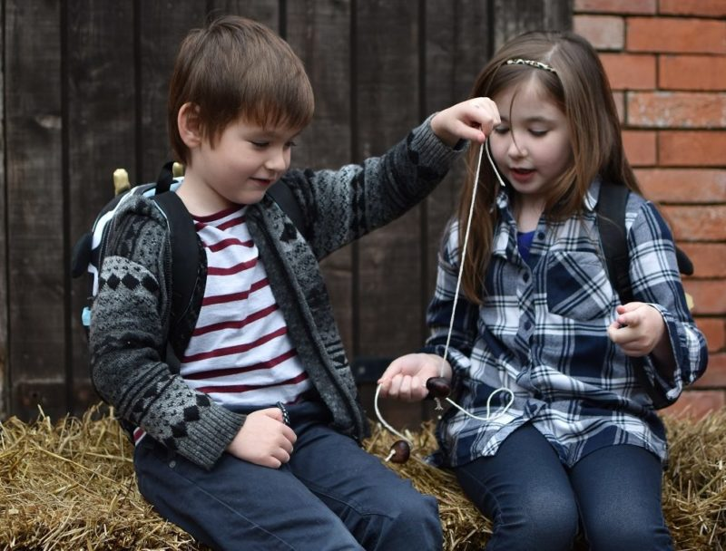 childen playing conkers by Peter Hall