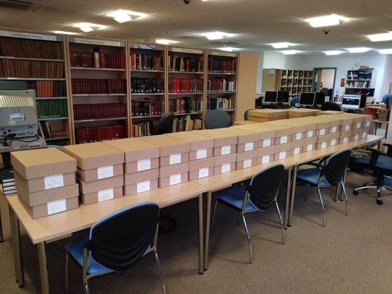 Archive boxes on a table in the Search Room
