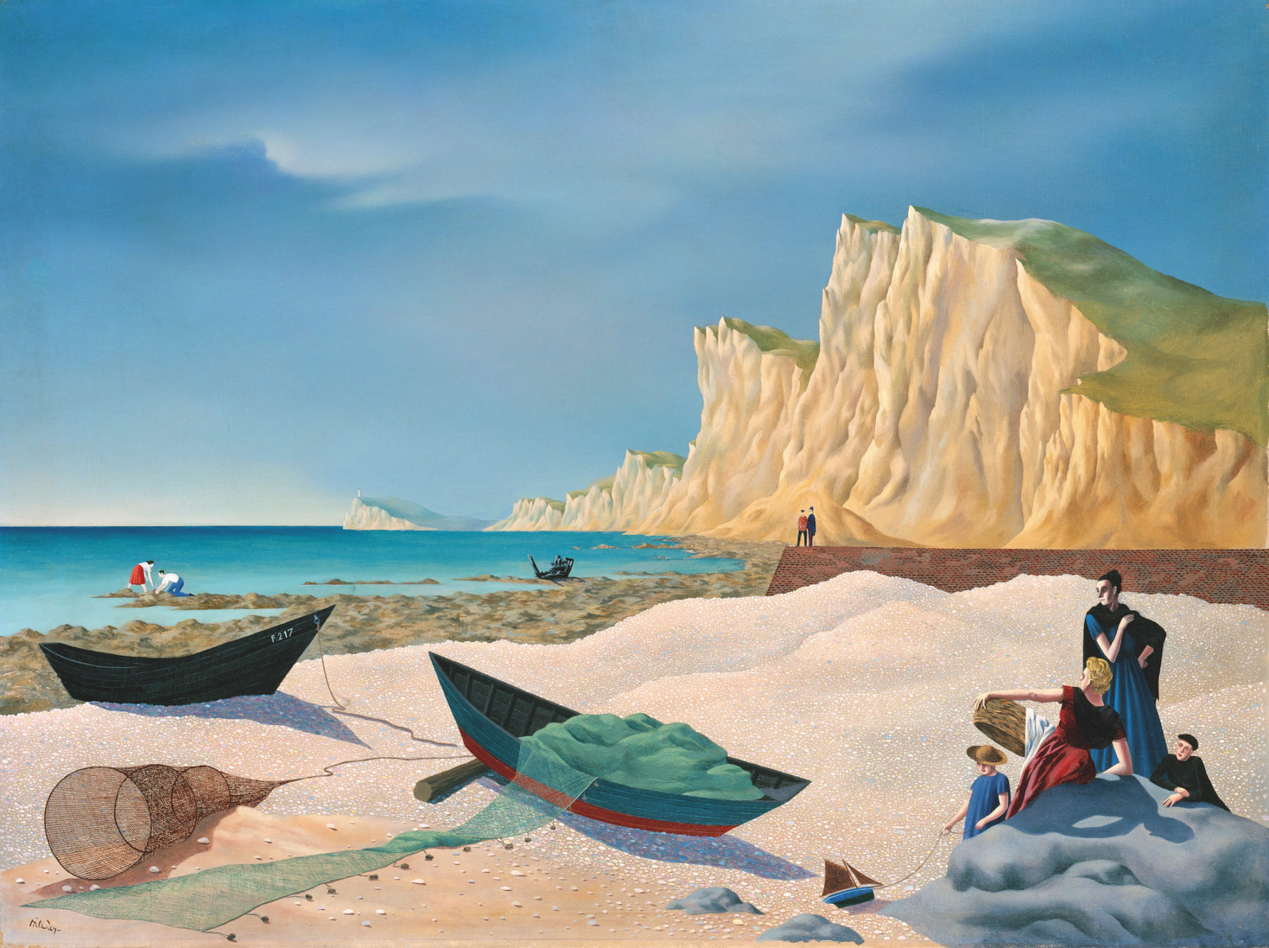 In the foreground of this beach scene is pebbled sand on which two rowing boats have been moored. In one of the boats a green fishing net has been piled in, with the end overhanging and laying on the sand. Two women, a girl and a boy lean against a rock. The women gaze out to sea, the girl at the toy boat she is holding, and the boy looks towards the viewer. Behind the sand is a brick jetty with two people standing on its edge. Rock pools jut out into the sea in front of the people. A lady and man stand crouching downwards on the rocks, and a ruined ships hulk sits atop the rocks. The sea is a deep blue-green. Overlooking the scene are crumbling cliffs and a lighthouse is in the distance.