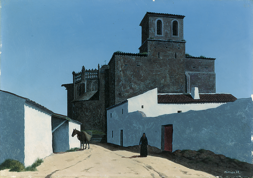 A sand coloured track is lined on either side by simple white washed buildings. The right building has long dark shadows across it. A dark brown church sits at the end of the road. A woman and donkey are the only signs of a living presence.