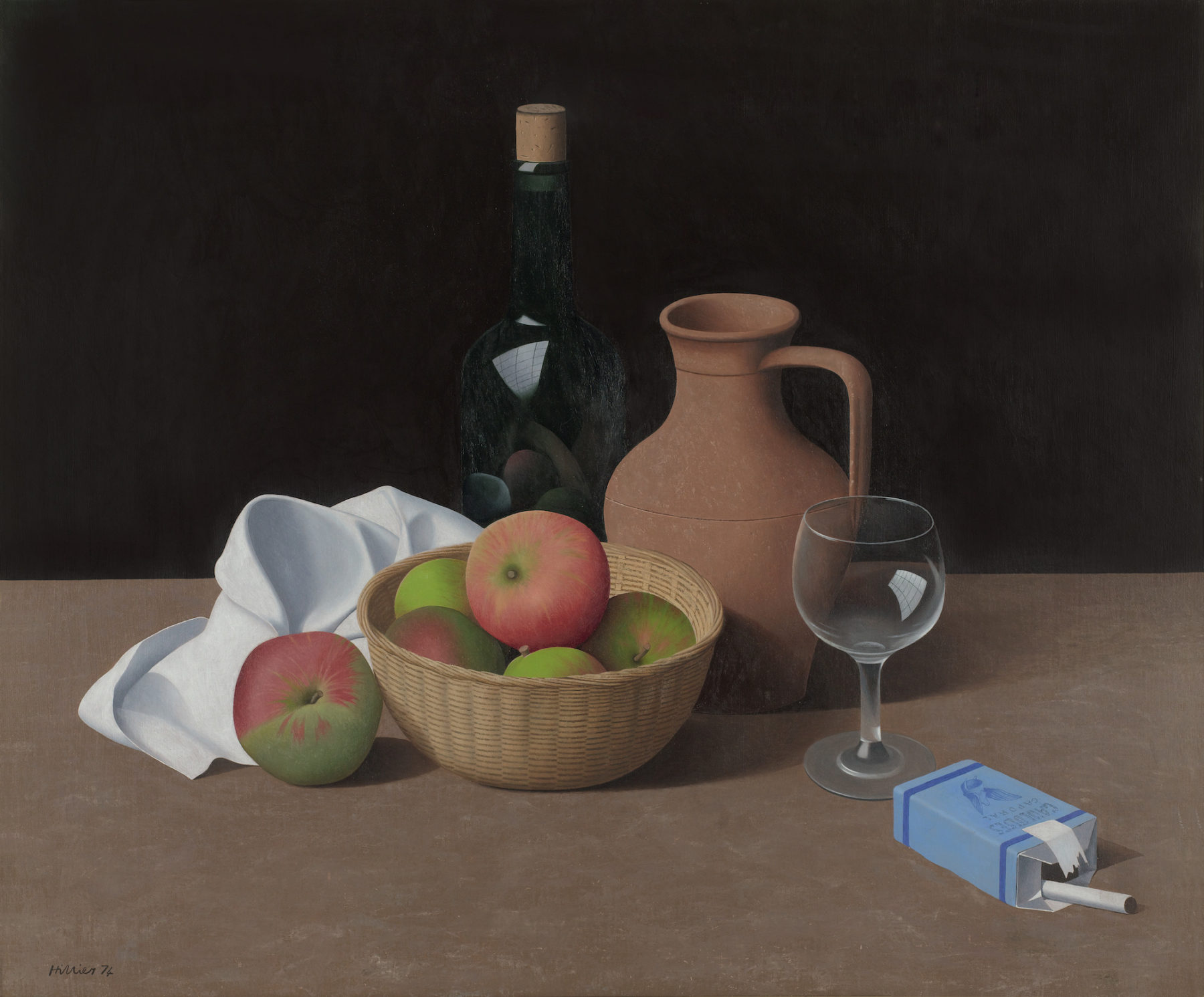 An assortment of objects form a still life composition on top of a wooden shelf against a pitch black backdrop. The objects are a scrunched up white napkin, a light brown woven bowl of red-green apples (one of which has fallen out and sits next to the napkin), a dark green cork bottle, a brown earthenware jug, a wine glass, and an open blue packet of cigarettes with one cigarette poking out of the top.