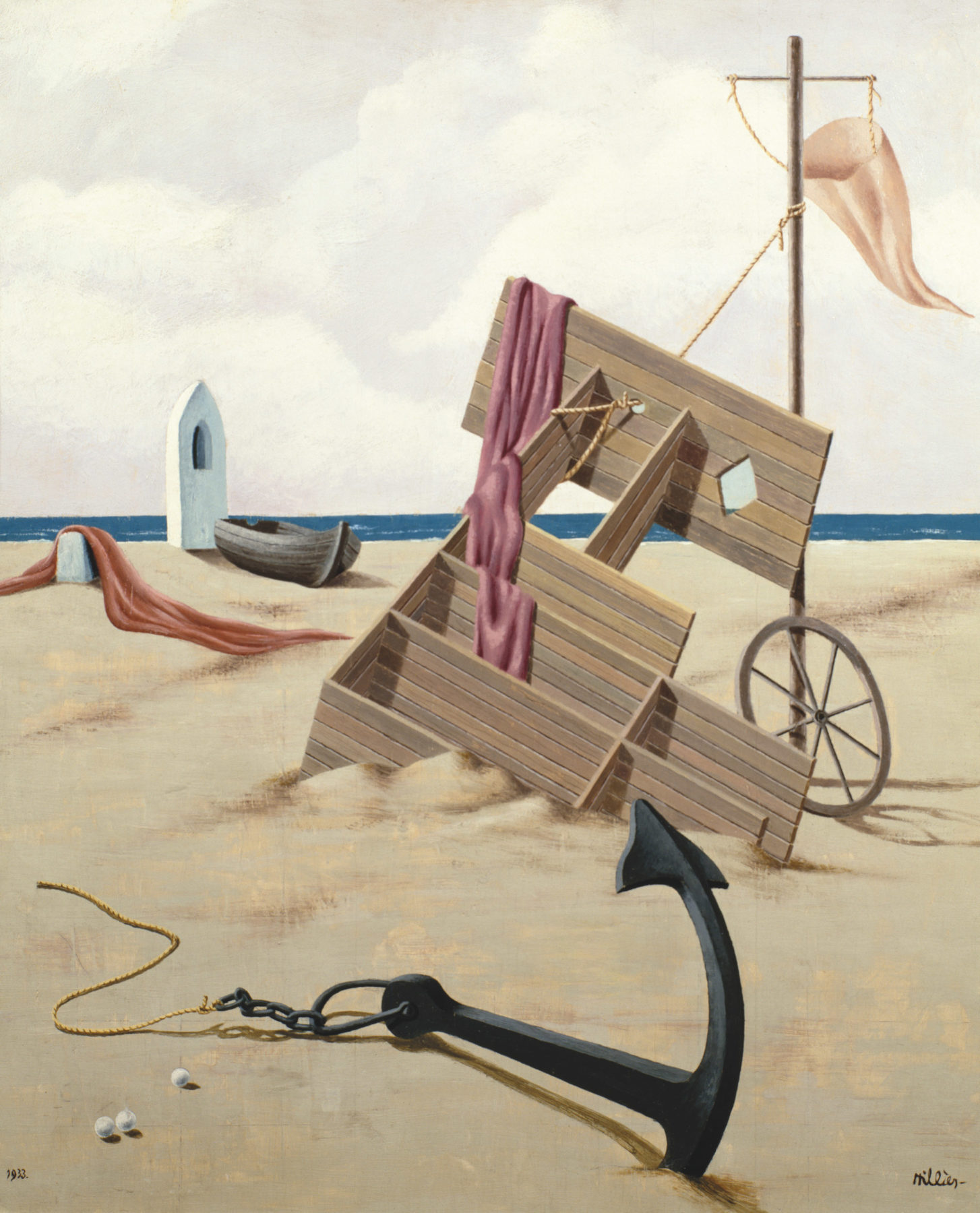 A sandy beach is shown against a bright but cloudy sky. Between the sand and the sky is a thin strip of deep blue sea. A capsized piece of furniture lies on the sand. A wheel leans against its side and there is a pink cloth draped over. Behind is another piece of pink draped cloth, a boat and a white beach hut. In the foreground there is a large black anchor.